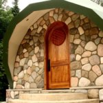 The round, carved symbol fits well with the arched door we made it for.