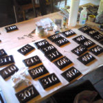 Mass production of acrylic plaques for a government housing project.