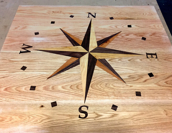 This compass star inlay was used as the landing of a staircase. The points of the star correspond with the direction that the house faces.