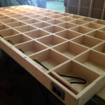 Torsion Box construction is used to create panels that are truly flat, by sandwiching a grid between flat 'skins' or panel. This one was used to build an excellent work table.