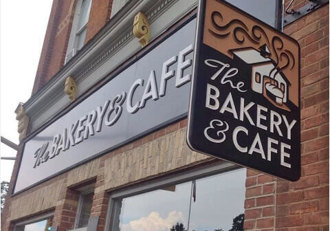 Raised lettering and the incised details of the overhanging sign make this bakery stand out in a quaint location.
